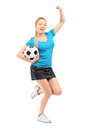 Full length portrait of a happy female holding football and chee Stock Images