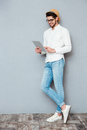 Full length portrait of a happy man using tablet computer Royalty Free Stock Photo