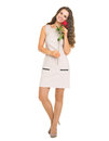 Full length portrait of happy young woman holding red rose high resolution photo Royalty Free Stock Photography