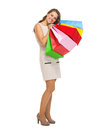 Full length portrait of happy young woman with shopping bags high resolution photo Stock Image