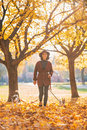 Full length portrait of happy young woman walking with dogs Royalty Free Stock Photo