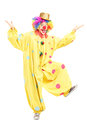 Full length portrait of a male funny circus clown posing isolated on white background Stock Photo