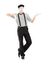 Full length portrait of a male mime artist gesturing with hand isolated against white background Royalty Free Stock Photo