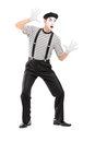Full length portrait of a male mime artist performing isolated on white background Royalty Free Stock Image