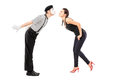 Full length portrait of a male mime artist and a young woman abo women about to kiss isolated on white background Stock Photos