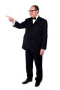 Full length portrait of male pointing Royalty Free Stock Photo