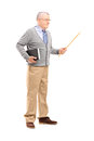 Full length portrait of a male teacher holding a wand and a book isolated on white background Royalty Free Stock Photography