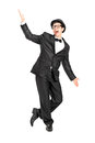 Full length portrait of a man in a bow tie suit dancing Royalty Free Stock Image