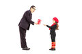 Full length portrait of a man giving present to a little girl men isolated on white background Royalty Free Stock Images