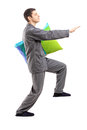 Full length portrait of a man in pajamas sleepwalking with a pillow in his hand on white background Stock Photo