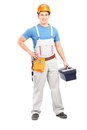 Full length portrait of a manual worker holding a tool box Stock Images