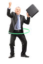 Full length portrait of a matue businessman dancing with a hula hoop isolated on white background Royalty Free Stock Photo