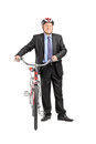 Full length portrait of a mature businessperson holding a bicycl bicycle isolated on white background Royalty Free Stock Photo