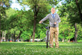 Full length portrait of a mature man with a bicycle in park Stock Image