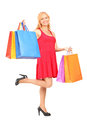 Full length portrait of a mature woman posing with shopping bags Stock Photo