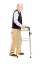 Full length portrait of a middle aged gentleman using a walker isolated on white background Royalty Free Stock Photo