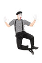 Full length portrait of mime artist jumping with joy isolated on white background Royalty Free Stock Image