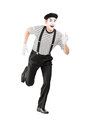 Full length portrait of a mime artist running and looking at cam camera isolated on white background Royalty Free Stock Image