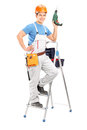 Full length portrait of a repairman with a hand drilling machine Stock Photography