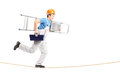 Full length portrait of a repairman running on a rope with a ladder Stock Photos