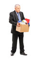 Full length portrait of a retired professional man with a box of belongings isolated on white background Royalty Free Stock Photo