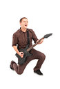 Full length portrait of a rock star playing a guitar isolated against white background Royalty Free Stock Photos