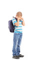Full length portrait of a sad schoolboy crying isolated on white background Royalty Free Stock Image