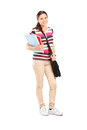 Full length portrait of a schoolgirl holding notebooks isolated on white background Royalty Free Stock Image