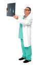 Full length portrait of senior surgeon Royalty Free Stock Image