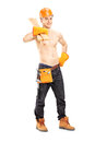 Full length portrait of a shirtless muscular male construction worker holding sills isolated on white background Stock Photo