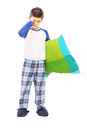 Full length portrait of sleepy kid holding a pillow isolated on white background Stock Photography
