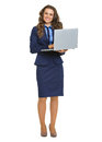 Full length portrait of smiling business woman with laptop isolated on white Royalty Free Stock Image