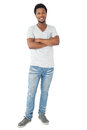 Full length portrait of a smiling man with arms crossed Royalty Free Stock Photo
