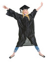 Full length portrait of smiling young woman in graduation gown jumping Stock Image