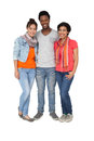 Full length portrait of three cool young friends standing over white background Stock Photography