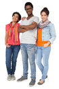 Full length portrait of three cool young friends standing over white background Stock Image
