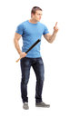 Full length portrait of a violent young man holding a baseball bat isolated on white background Stock Photo