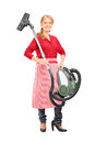 Full length portrait of a woman holding a vacuum cleaner isolated on white background Stock Photography