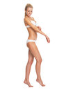 Full length portrait of woman in lingerie checking arm skin