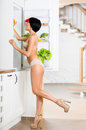 Full length portrait of woman near the opened fridge Stockfotos