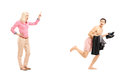 Full length portrait of a woman shouting at a naked guy running women away isolated on white background Royalty Free Stock Images