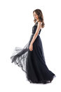 Full length portrait of young beautiful woman in black evening d