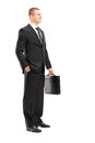 Full length portrait of a young businessman with briefcase posin posing isolated on white background Royalty Free Stock Photography