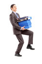 Full length portrait young businessman carrying heavy folders white background Stock Photos