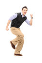 Full length portrait of a young cheerful man gesturing happiness Stock Photo