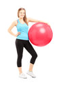 Full length portrait of a young female athlete holding a ball fitness isolated against white background Royalty Free Stock Photography