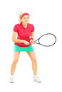 Full length portrait of young female tennis player holding a rac racket isolated on white background Royalty Free Stock Image