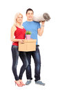 Full length portrait of a young male and female holding a moving Royalty Free Stock Photos