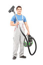 Full length portrait of a young male worker holding a vacuum cle Stock Image