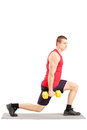 Full length portrait of a young man exercising with weights isolated on white background Royalty Free Stock Photography